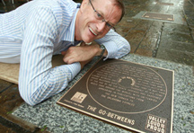 Brisbane's Deputy mayor David Hinchcliffe with The Go-betweens plaque in the Walk Of Fame